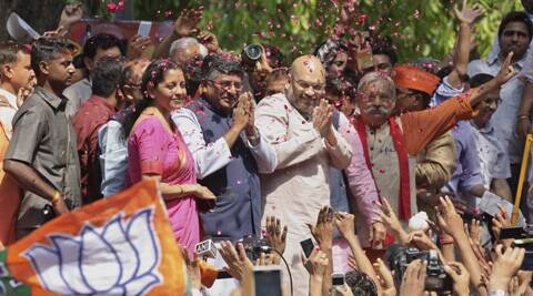 BJP leader Amit Shah celebrates with party supporters. ( Source: AP )
