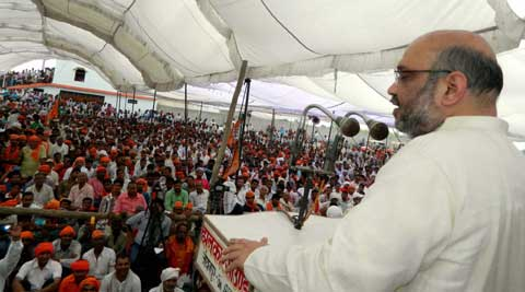 BJP leader Amit Shah addressing an election rally for party candidate in Azamgarh on Sunday. (Photo: PTI)
