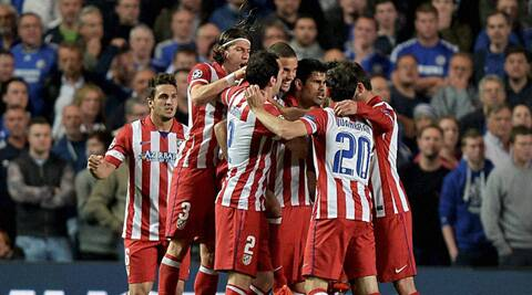 Atletico Madrid players celebrate their victory against Chelsea in Champions League semifinal on Wednesday. (AP)