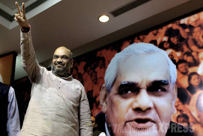 Amit Shah flashes a victory sign in front of Atal Behari Vajpayee's cutout. (Source: Express Photo by Ravi Kanojia)