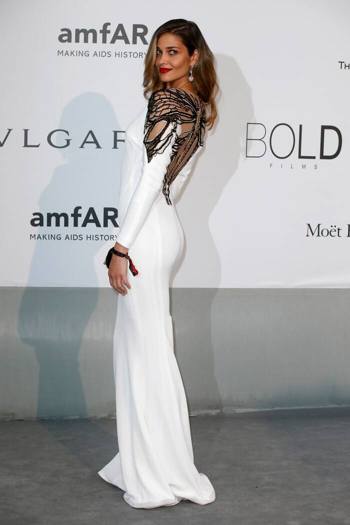 Model Ana Beatriz Barros showed off her slender figure in a white gown with cutout patterned back. (Source: Reuters)