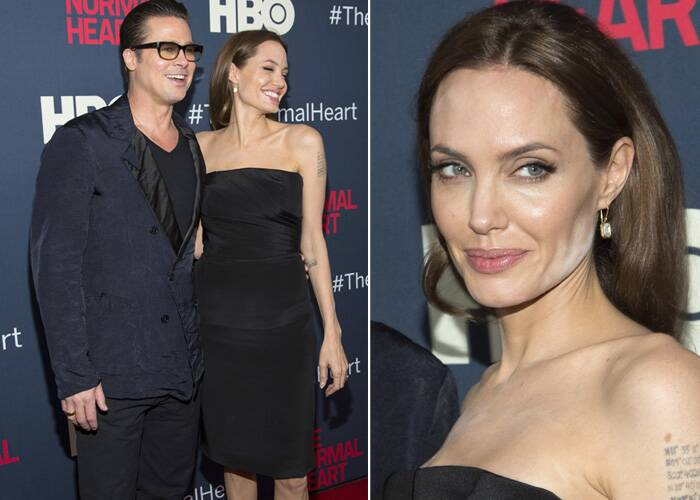 At a film premiere, the almost-perfect Angelina Jolie had some white powder along her cheekbone.