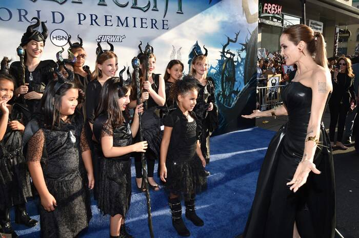 Angelina Jolie interacts with young girls dressed as her character Maleficent at the premiere. (Source: AP)