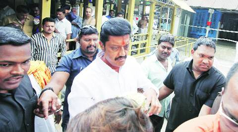 Newly-elected Pune city MP Anil Shirole is surrounded by several bodyguards.