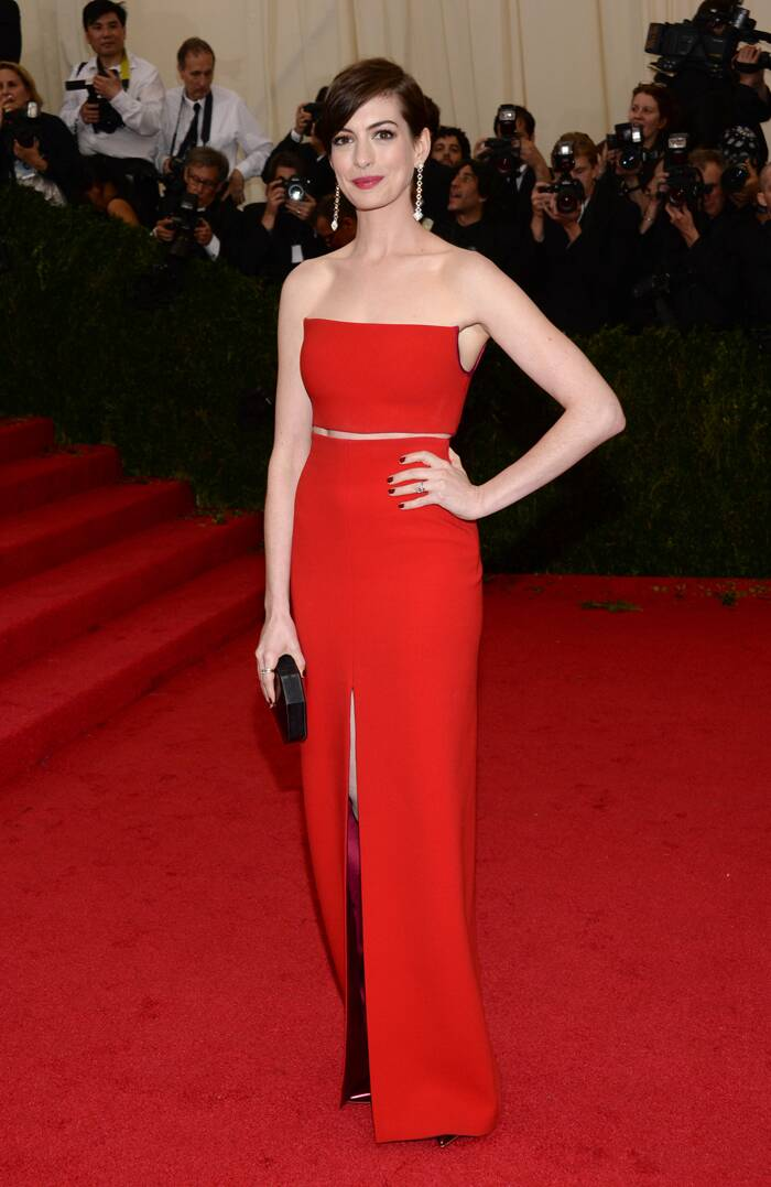 Actress Anne Hathaway looked ravishing in a scarlet bustier and skirt by Calvin Klein with Gianvito Rossi shoes and Vhernier earrings. She finished off her look with a black Rauwolf clutch.  (AP)