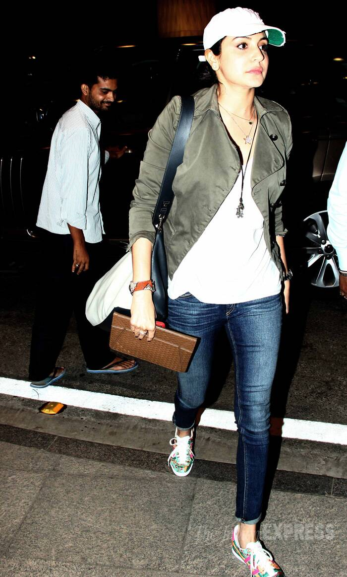 Anushka Sharma was casual in jeans, shirt and a baseball cap at the Mumbai airport. (Source: Varinder Chawla)