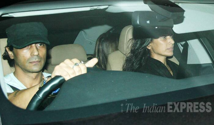 Arjun Rampal drives in for the movie date with wife Mehr. (Source: Varinder Chawla)