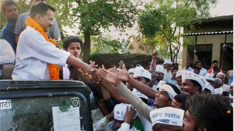 AAP leader Arvind Kejriwal shakes hands with people in Varanasi on Tuesday. (Photo: PTI)