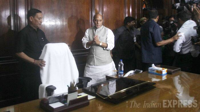 The country's new Union Home Minister Rajnath Singh took charge of his office on Thursday, (May 29). Rajnath Singh was elected from the Lucknow Lok Sabha constituency, has succeeded Sushilkumar Shinde in the crucial ministry. <br /> Rajnath Singh at the Union Home Minister office at north block in New Delhi on Thursday. (Source: IE Photo by Anil Sharma)
