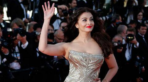 Aishwarya Rai Bachchan picked a dazzling gold strapless mermaid-cut gown by Roberto Cavalli for this year at Cannes.