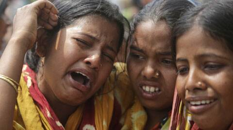 Relatives of victims killed in ethnic violence mourn at a burial ground at Narayanguri village in Assam. (Photo: AP)
