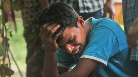 A man cries near the body of a relative, killed in ethnic violence, at a burial ground at Narayanguri village. (AP)