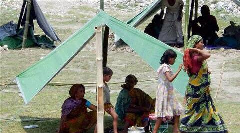Violence affected people take shelter at a relief camp at Naryanguri in Baksa, Assam on Wednesday. (PTI)