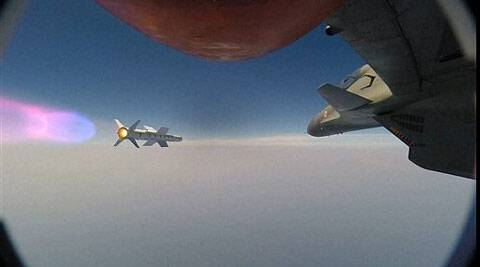 ASTRA air-to-air missile being fired from SU-30MKI combat aircraft over a naval firing range in the western sector . (PTI)