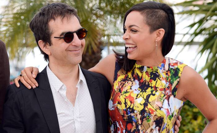 Seen here, Rosario Dawson shows off her funky hairdo as she shares a laugh with 'Captives' director Atom Egoyan. (Source: AP)