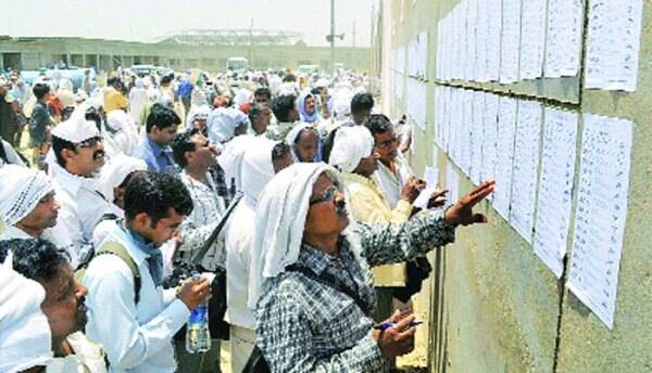 People check names in electoral list in Azamgarh on Sunday. PTI