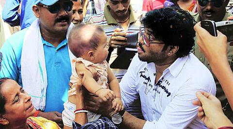 Babul Supriyo makes new friends during campaign in Asansol. Arshad Ali
