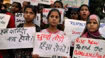 Protest against teenaged sisters gangraped