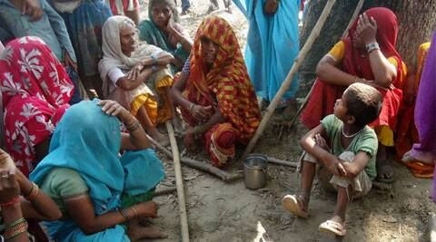 Badaun:  Relatives of two dalit teenaged sisters who were hanged after being allegedly gangraped in Badaun district on Wednesday. (Source: PTI)