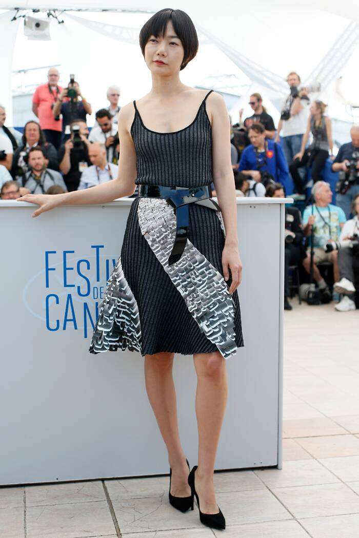 Her co-star Bae Doona opted for a belted strappy dress with black pumps as she too posed for the photogs. (Source: AP)