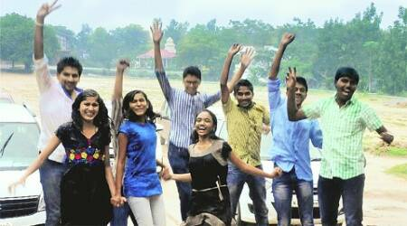 Students celebrate their success in the second year PUC examination in Chikmagalur Thursday. (PTI)