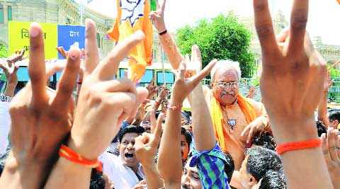 State BJP chief Laxmikant Bajpai celebrates outside party head office, in Lucknow Friday.