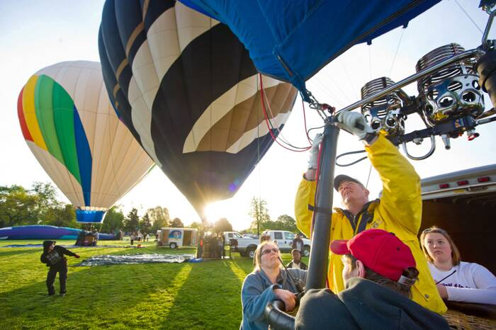 "Blue Mountain Balloons' Jeff ""Kong"" Shields inflates during the Media Flight. (AP)"