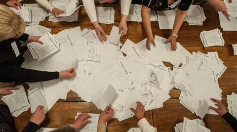 Members of election committee count ballots after voting closed at a polling station in Donetsk, Ukraine, Sunday, May 11, 2014.  AP/ Photo