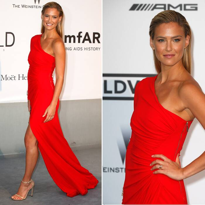 Israeli fashion model and Leonardo Di Caprio's ex girlfriend Bar Rafaeli went red in a sexy one-shouldered gown by Roberto Cavalli and gold ankle-strapped heels. (Source: Reuters)