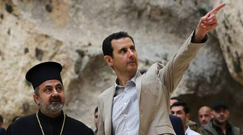 Syrian President Bashar Assad, right, visits the Christian village of Maaloula, near Damascus, Syria. (AP)