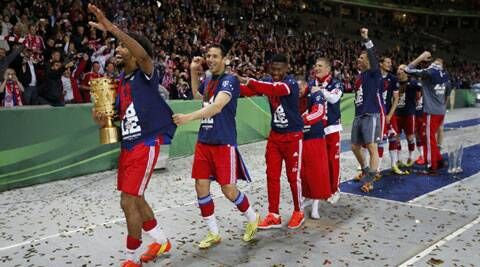 Bayern Munich's Dante leads the celebrations after winning the German Cup against Borussia Dortmund in Berlin. (Reuters)