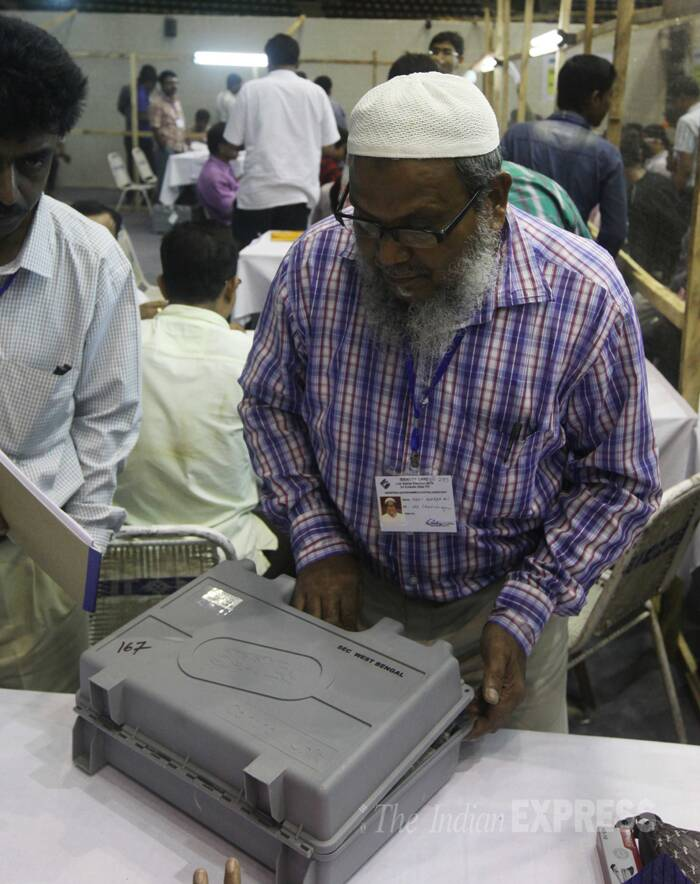 Election personnel and polling agents of differnt political parties during the vote counting at Netaji Indoor stadium in Kolkata on Friday (May 16) (Source: Express photo by Partha Paul)