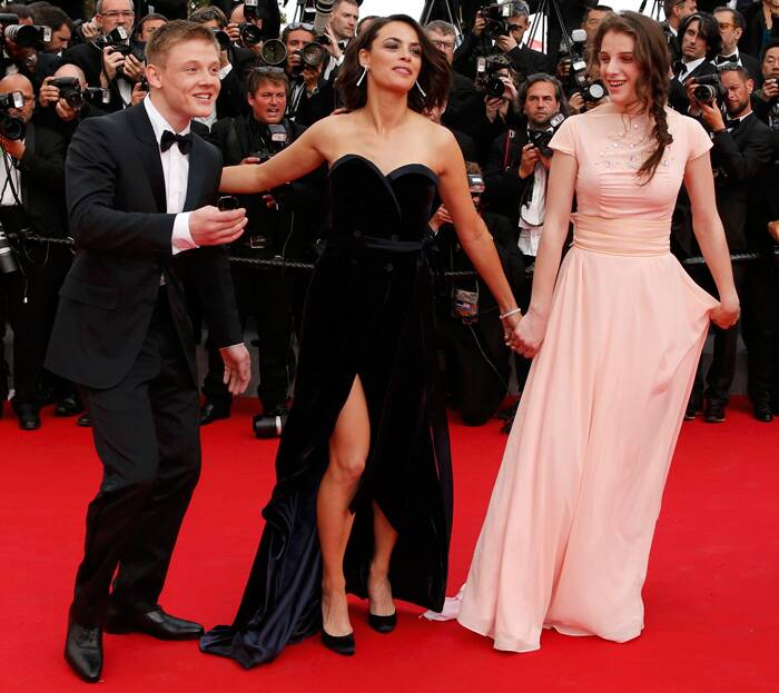 The cast of 'The Search' - Maxim Emelyanov, Berenice Bejo and Zukhra Duishvili pose on the red carpet as they arrive for the screening of their film at the 67th Cannes Film Festival. (Source: Reuters)