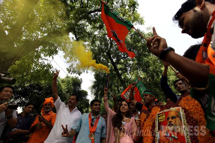 BJP celebrating outside the party's headquarters. (Source: Express photo by Ravi Kanojia)