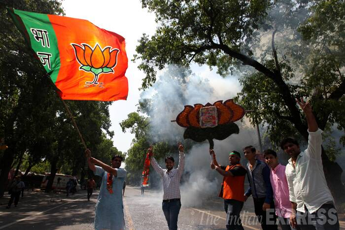 BJP workers were seen celebrating outside the party's headquarters in New Delhi afer the party registered an emphatic win in 16th Lok Sabha elections. (Source: Express photo by Ravi Kanojia)