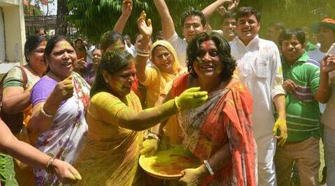 BJP supporters celebrate the party's thumping win in the Lok Sabha polls. (PTI)