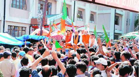 BJP candidate Anurag Thakur celebrates with his father and former CM Prem Kumar Dhumal at Hamirpur on Friday. PTI