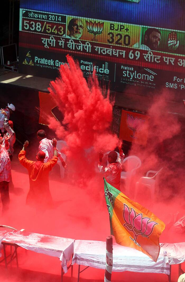Party workers smear gulaal in the streets as part of celebrations. (Source: Express Photo by Sandeep Daundkar)