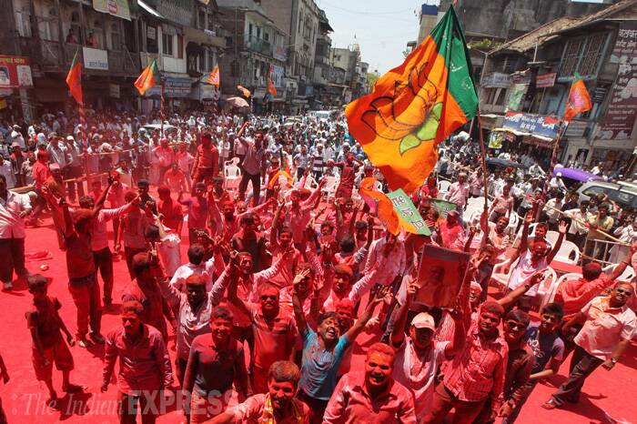 BJP workers celebrating the party victory in the Lok Sabha elections as party candidate Anil Shirole winning with a large vote margin in Pune. (Source: Express Photo by Sandeep Daundkar)