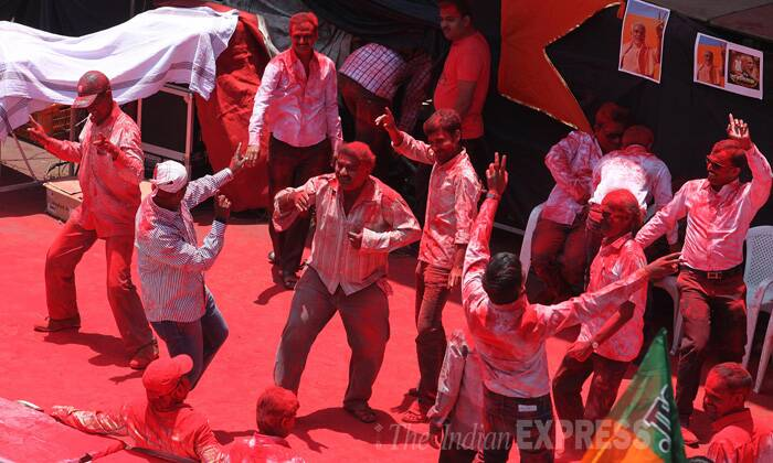 BJP party workers dance during the celebrations. (Source: Express Photo by Sandeep Daundkar)