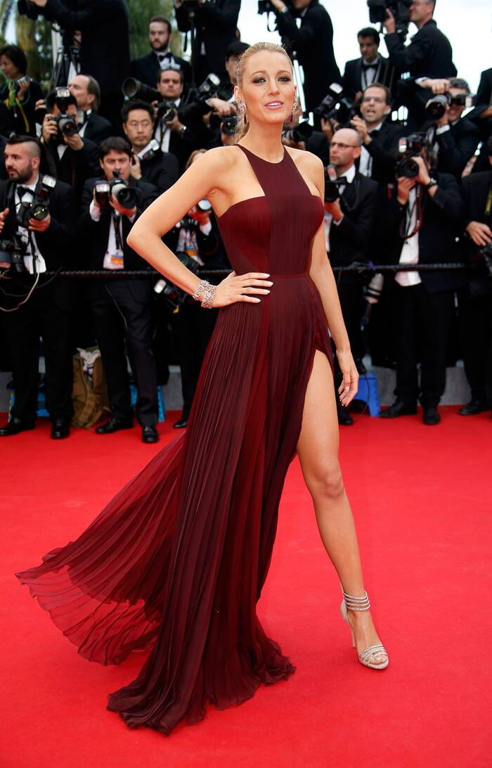 'Gossip Girl' Blake Lively made heads turn with her bold burgundy gown with a thigh-high slit by Frida Gianni. <br /><br /> Seen here, the actress poses for the red carpet Angelina Jolie style, as she arrived for the opening ceremony of the 67th Cannes Film Festival and the screening of the 'Grace of Monaco'. (Source: Reuters)