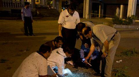Pakistani investigators examine a crater caused by a bomb blast in Islamabad, Pakistan. (Source: AP photo)
