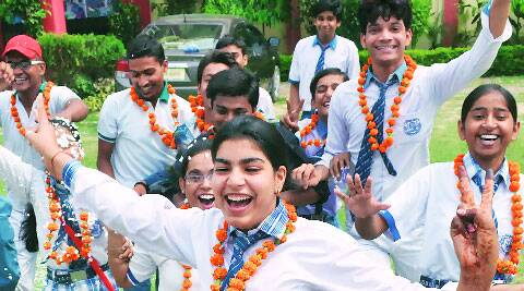 Students celebrate after the results for Class 12 were declared, at St Joseph College in Lucknow, Sunday. (Source: Express photo by Pramod Singh)