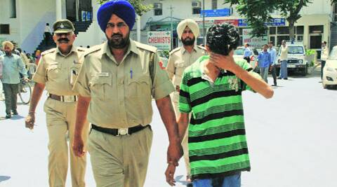 The accused after his arrest in Chandigarh. ( Source: Express photo )