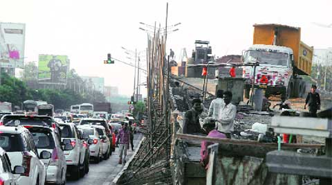 Repair work at Dindoshi bridge and Bandra-Khar flyover caused traffic jam on Western Express highway on Tuesday.
