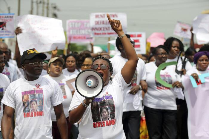 Activists shout slogans and hold signs during a protest for the release of the abducted secondary school girls in the remote village of Chibok, along a road in Lagos. ( Source: Reuters )
