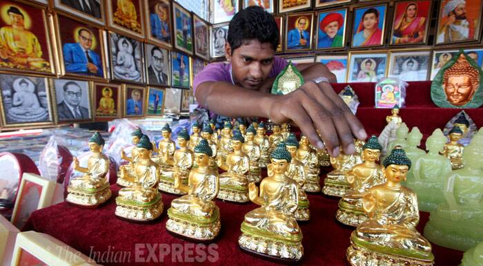 A vendor is seen selling the statues of Lord Buddha at Shivaji Park, Mumbai on Wednesday. (Source: Express photo by Prashant Nadkar)