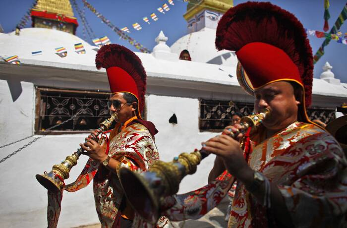 Buddhist monks play traditional instruments and circumambulate the world heritage site Boudhanath Stupa during Buddha Jayanti in Katmandu. (Source: AP)