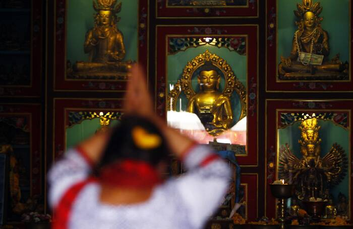 A Buddhist woman offers prayers at a monastery during Buddha Jayanti in Katmandu. (Source: AP)