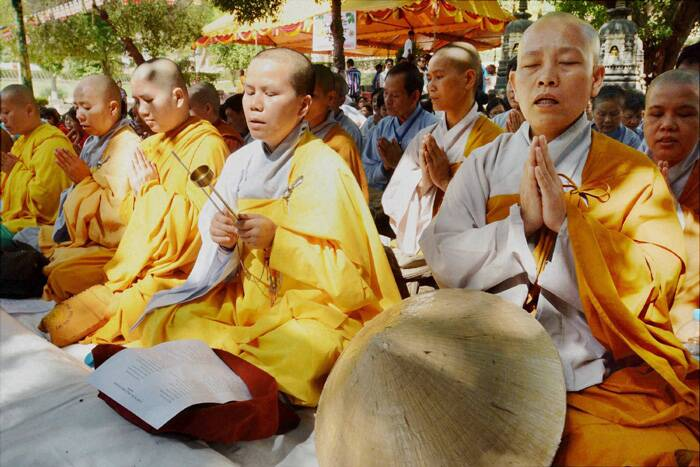 Devotees from Vietnam offering special prayers at Maha Bodhi Temple on the occasion of 2558th Buddha Poornima at Bodhgaya. (Source: PTI)